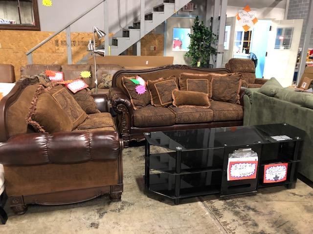 Rj's Discount Store couches and entertainment table